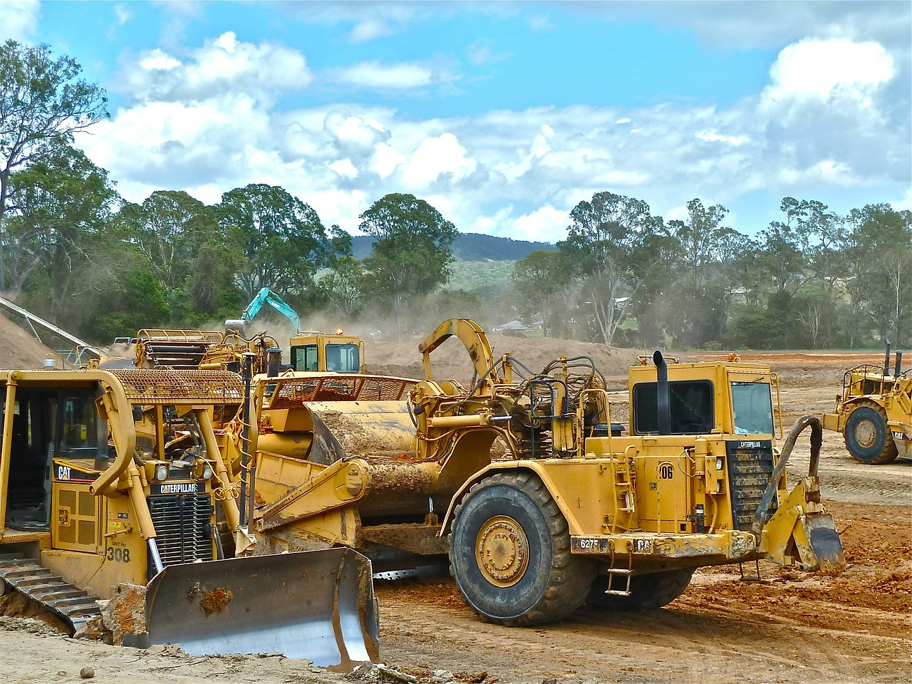 A Caterpillar bulldozer in forefront.